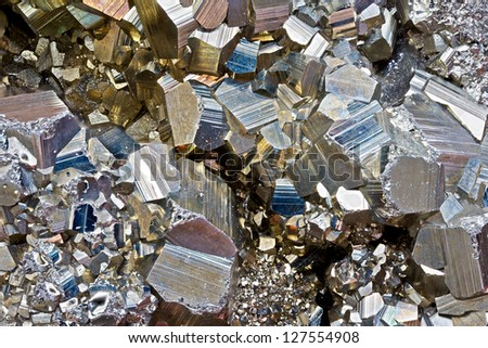 Close-up image of pyrite (fool's gold) crystals at 2x magnification. - stock photo