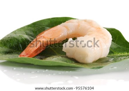 Close-up image of shrimp with spinach leaves
