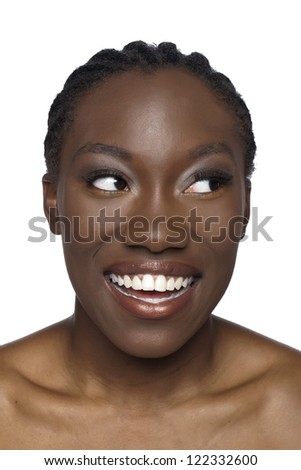 Close-up image of smiling African woman looking at the side over the white background