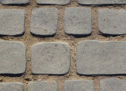Close-up image of stepping stones and dirt texture.