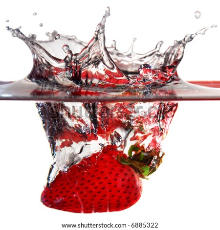 Close-up image of strawberry dropped to water