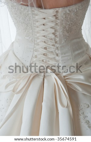 CloseUp Image Of The Detailed Laces On The Back Of A Wedding Dress Stock