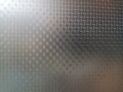 Close-up image of the glass opaque film window surface with light and shadow. The abstract picture of glass opque film backgound for decorative design and advertising.
