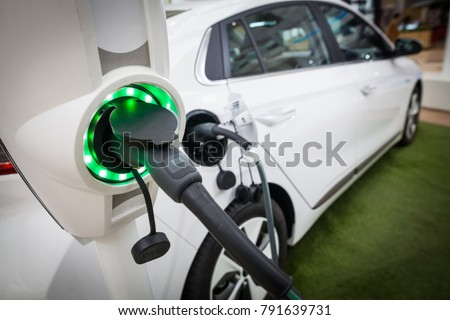 Close up image of the power socket of an electric car, charging.