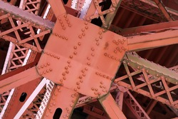 Close-up image of the steel girders forming the underside of the Golden Gate Bridge.