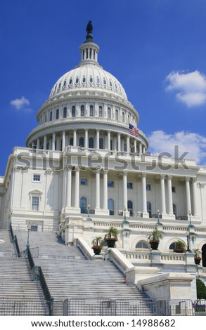 Close up image of the US Capitol. Versatile image that could be used to represent politics, power, government, traveling, policy debates, elections. - stock photo