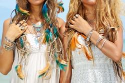 close up image of two hippie girls. boho style