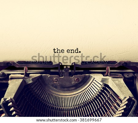 close up image of typewriter with paper sheet and the phrase: THE END . copy space for your text. retro filtered  #381699667