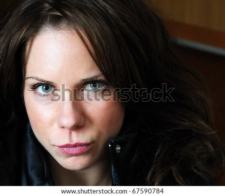 Close up image of young beautiful caucasian female with black jacket