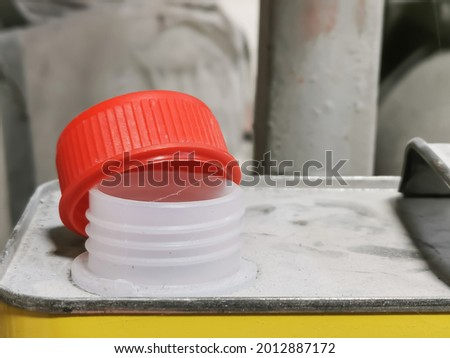 Close up image plastic red cap of thinner canned against blurry background. Selective focus. Stock photo ©