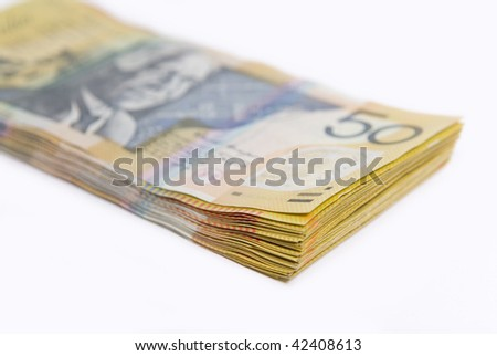 Close up image showing stack of Australian fifty dollar bills isolated on white
