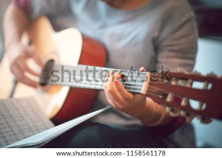 Close up images of girl playing guitar