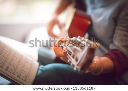 Close up images of girl playing guitar  #1158561187