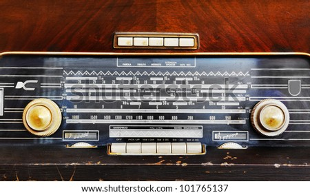close up in a worn antique wooden radio - stock photo