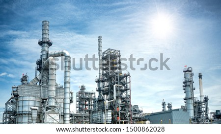 Close up Industrial view at oil refinery plant form industry zone with sunrise and cloudy sky #1500862028