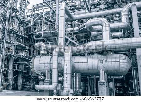 close up Industrial zone,The equipment of oil refining,Close-up of industrial pipelines of an oil-refinery plant,Detail of oil pipeline with valves in large oil refinery, power energy system station. #606563777