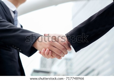 close up investor businessman handshake with partner , ceo leader hand shake for agreement or approve or deal financial ,we are hiring concept
