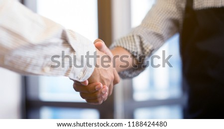 close up investor businessman handshake with partner for successful,ceo leader agreement or approve and deal financial and social distance concept
