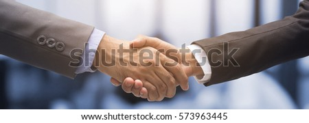 close up investor businessman handshake with partner for successful,ceo leader agreement or approve and deal financial concept