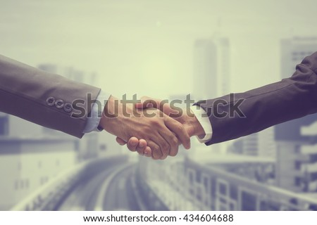 close up investor businessman handshake with partner vendor,collaboration of two ceo leader hand shake for agreement concept.