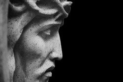 Close up Jesus Christ crown of thorns. Fragment of an ancient stone statue.
