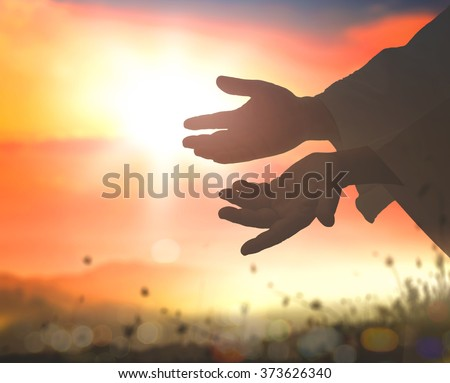 Close up Jesus Christ hands open palm up on blurred sunset background. Mercy Humble Repentance Reconcile Adoration Glorify Christmas Redemption Redeemer  Love Blessed God Hope Help Christian concept
