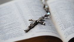 Close up Jesus Cross pendant on Bible.Crucifixion Of Jesus,Victory of Christ over sin and death,Forgiving sin,God love, Easter time,Faith God.Christianity background.