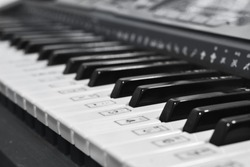 Close-up keyboard synthesizer piano, Synthesizer knobs. electronic musical instrument.