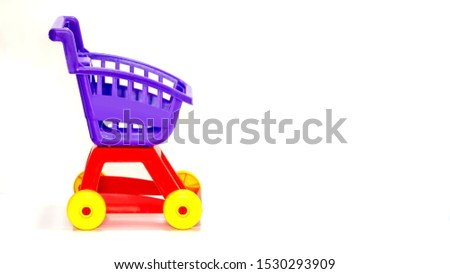 close up Kids toy grocery trolly cart macro photography isolated on white background