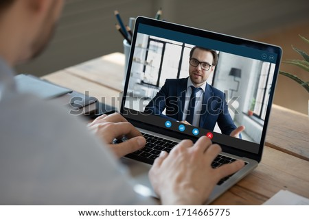 Close up laptop screen, businessman making video call, participating in online conference, typing on keyboard, business partners negotiations in internet, hr manager holding remote job interview