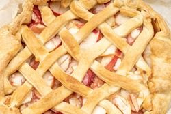 close up latticed american apple pie above view. background backdrop. studio shot. fresh traditional fruit pie.