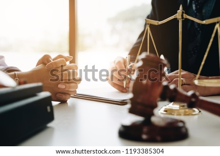 Close up lawyer or judge consult having team meeting with client, Law and Legal services concept. #1193385304