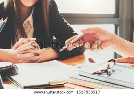 Close up lawyer or judge consult having team meeting with client, Law and Legal services concept.