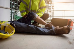 Close up leg of worker accident in site work, Basic first aid training for support accident in site work.
