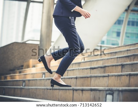 Close up legs of businesswoman walking stepping up stair in modern city, business growth, go up, success, grow up business concept #713142652