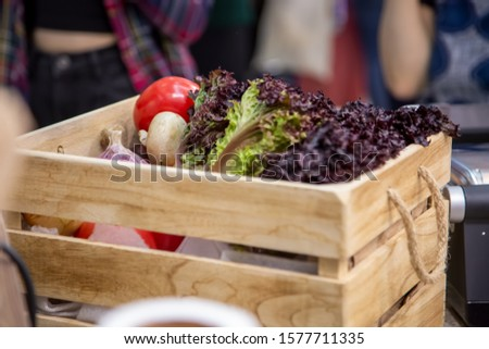 close up lght wooden box with set of fresh organic vegetables garlic, champignons, onion, tomatoes, lettuce leaves. Concept of biological, bio products, bio ecology, vegetarians, farm, crop. #1577711335