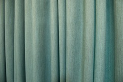 Close up light blue turquoise color curtain texture background