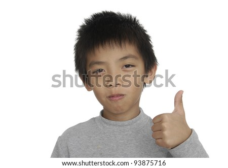 Close up  little boy giving you thumbs up - stock photo