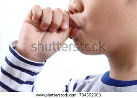 Close up little boy sucking thumb