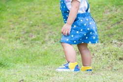 Close up little girl Asian happiness running on lawn, 1-2 year old