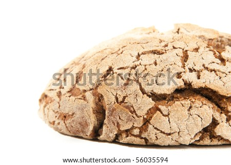 close-up loaf of hot whole rye homemade bread just out of oven and isolated on white background
