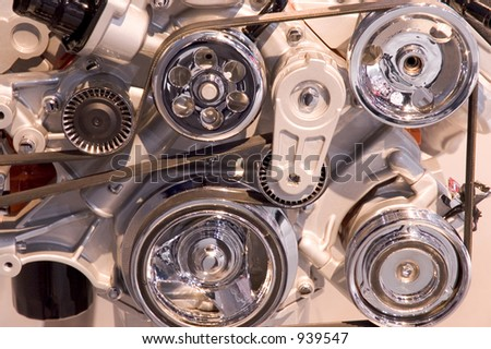 Close-up look at a modern automobile engines belts and pulleys.