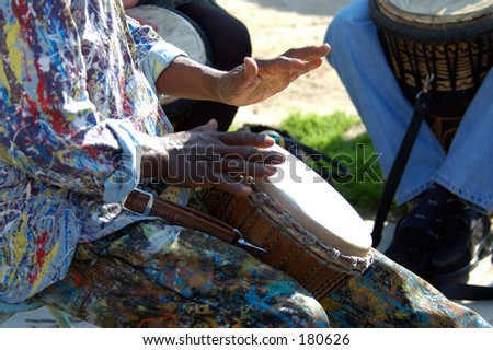 Close up look at the hands of a street performing drummer - stock photo