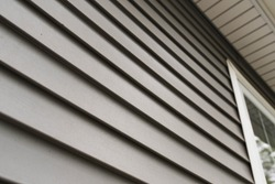 Close up look at vinyl siding on a new home.