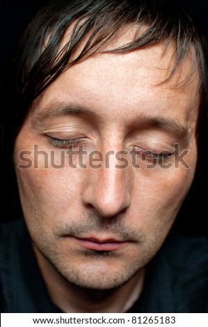 Close up low key portrait of an adult male sleeping