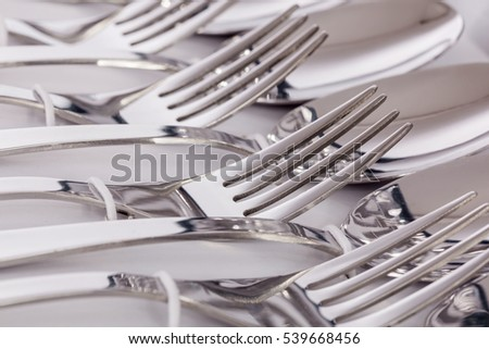 Close up macro detail of a flatware box set with forks and spoons.