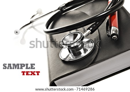 Close up macro of a black diary with red pen and a medical stethoscope on a white background with space for text