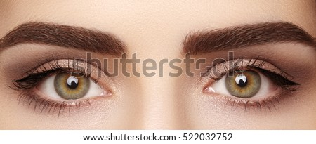 Close-up macro of beautiful female eye with perfect shape eyebrows. Clean skin, fashion naturel make-up. Good vision - Shutterstock ID 522032752