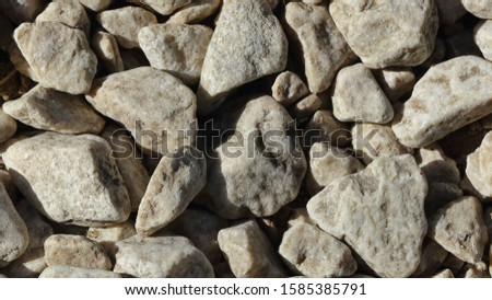 Close up macro of the texture and shapes of stone chips on a gravel path