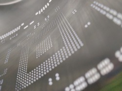 Close-up macro shot of a laser cut stainless steel stencil for solder paste application of printed circuit boards (PCB) for surface mounted (SMT) electronic components